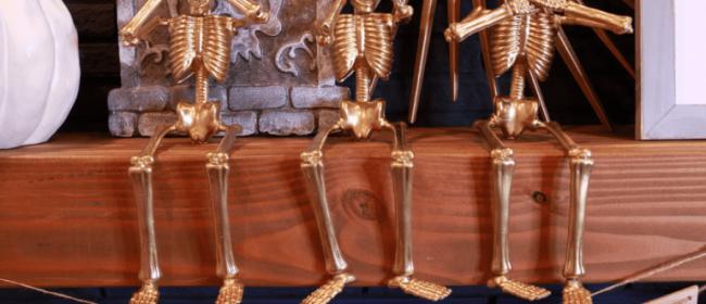 Remodelaholic | Cheap & Easy DIY Halloween Decor: Dollar Store Gold Skeletons