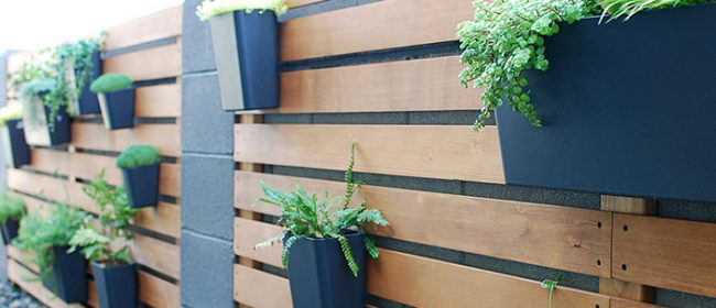 Remodelaholic | DIY Wood Slat Garden Wall with Planters
